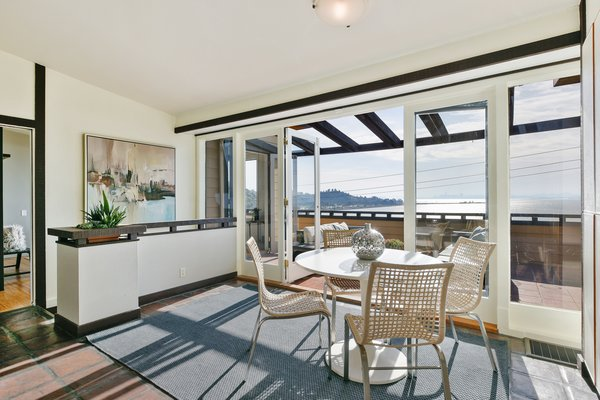 Full height glass doors allow the viewing terrace to blend seamlessly into the interior breakfast nook.