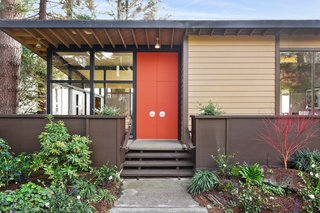 A Bay Area Jewel With Golden Gate Views Wants $1.55M - Photo 1 of 14 - A midcentury modern color palette decorates the exterior. Brightly colored doors highlight the home's entry.