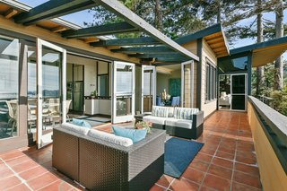A Bay Area Jewel With Golden Gate Views Wants $1.55M - Photo 12 of 14 - Exterior terraces wrap public living spaces.  A wooden pergola shades the exterior sitting space.