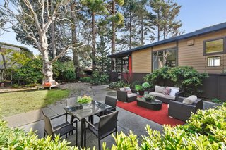A Bay Area Jewel With Golden Gate Views Wants $1.55M - Photo 13 of 14 - Outdoor entertainment spaces are aplenty on the homes extensive grounds.