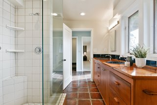 A Bay Area Jewel With Golden Gate Views Wants $1.55M - Photo 9 of 14 - A full bath with a double vanity and walk-in shower is accessible from both bedrooms on the lower level.