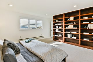 A Bay Area Jewel With Golden Gate Views Wants $1.55M - Photo 8 of 14 - Built-in bookshelves frame the master bedroom.