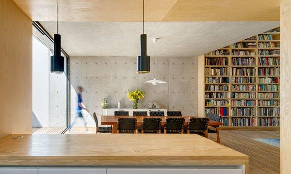 Simple Alvar Aalto pendants hang below the wooden ceiling in the kitchen.