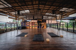 Forget Coworking—These Coliving Spaces Let You Travel the World For $1,800 a Month - Photo 10 of 25 - Roam Bali open-air yoga deck