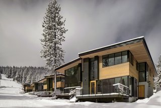 These Contemporary Lake Tahoe Chalets Have Ski-In, Ski-Out Access - Photo 2 of 11 - Western red cedar siding wraps the exterior of the townhomes as they step down the ski slope. Anderson E-windows frame views of the mountainside.