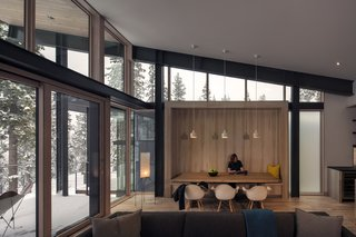 These Contemporary Lake Tahoe Chalets Have Ski-In, Ski-Out Access - Photo 7 of 11 - A wood-framed banquette punctuates the dining space. Herman Miller Eames Shell Chairs and Alvar Aalto Pendants decorate the eating area.