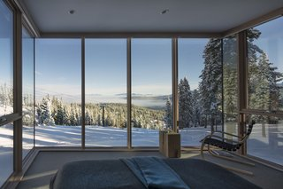 These Contemporary Lake Tahoe Chalets Have Ski-In, Ski-Out Access - Photo 8 of 11 - Surrounded by glazing on three sides, the master is a suite above the slopes, surrounded by nature.