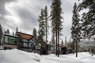 These Contemporary Lake Tahoe Chalets Have Ski-In, Ski-Out Access - Photo 9 of 11 - Western red cedar, stained black, gray, and natural, wrap the facades of the residences. Roof canopies reach outwards to engage with the homes' setting. Windows by Sierra Pacific provide incredible views of the surroundings.