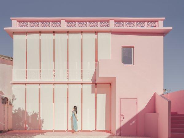 Curtains wrap Her House like a veil, creating a feminine solution for a new facade.