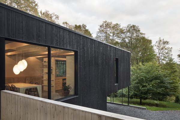 This Wood-Clad Home Is Built Into a Serene Mountain Slope - Photo 3 of 16 - The hovered volume places minimal impact on the site, respecting the topography and natural conditions.