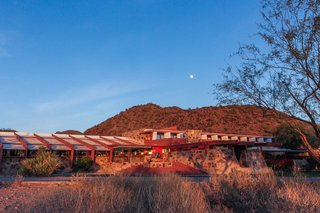 Tour Frank Lloyd Wright's Spectacular Desert Retreat and School in Arizona - Photo 3 of 13 - Rich red hues and earthy sandy tones create a close relationship between the buildings and the landscape.