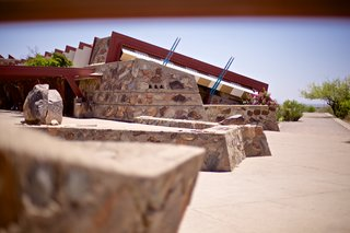 Tour Frank Lloyd Wright's Spectacular Desert Retreat and School in Arizona - Photo 5 of 13 - The rock wall formations ground the buildings into the desert landscape.