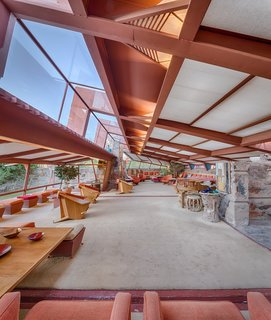 Tour Frank Lloyd Wright's Spectacular Desert Retreat and School in Arizona - Photo 7 of 13 - Roof overhangs moderate the amount of light that fills the space.  The redwood structure remains exposed on the interior, creating a seamless exterior to interior connection.