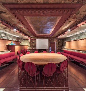 Tour Frank Lloyd Wright's Spectacular Desert Retreat and School in Arizona - Photo 12 of 13 - The Kiva Room, a half-submerged space,  doubled as a conference room and movie theater for the Taliesin Fellowship.  Today, the space displays beauty and culture through craft and detailing.
