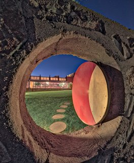 """Tour Frank Lloyd Wright's Spectacular Desert Retreat and School in Arizona - Photo 6 of 13 - Deeply influenced by Asian culture, art, and design, Wright reflected some of that influence into the design of Taliesin West.  Here, the """"Moon Gate,"""" a circular opening, displays a hint of the Eastern influence."""