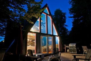 11 Alluring A-Frame Homes You Can Rent Right Now - Photo 8 of 11 - A cozy A-frame with views of Whiteface Mountain, this dwelling features a living room, fireplace, loft bedroom, and fully equipped kitchen.