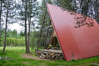 11 Alluring A-Frame Homes You Can Rent Right Now - Photo 9 of 11 - This modern A-frame is surrounded by miles of hiking, hidden swimming holes, and amazing vistas. With a distinctive red roof and an additional teepee tent available to rent, this cabin is the ideal getaway to experience Yosemite.