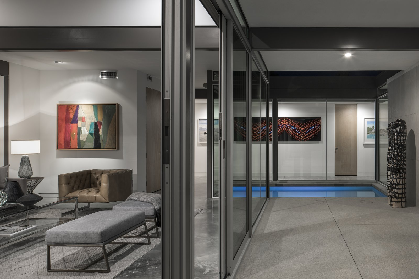 Further emphasizing the indoor-outdoor connection is a water feature which extends between spaces.