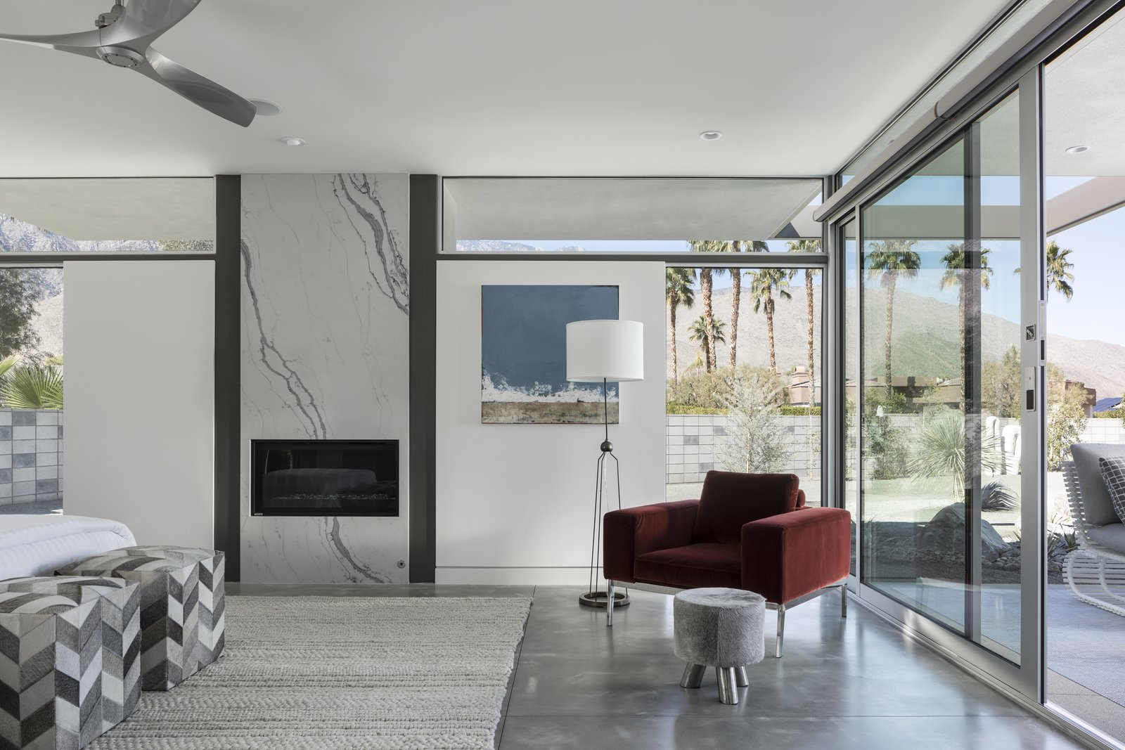 The Master Bedroom is completed with an elegant fireplace and glass surrounds.  Large, sliding glass doors open directly onto the outdoor patio.