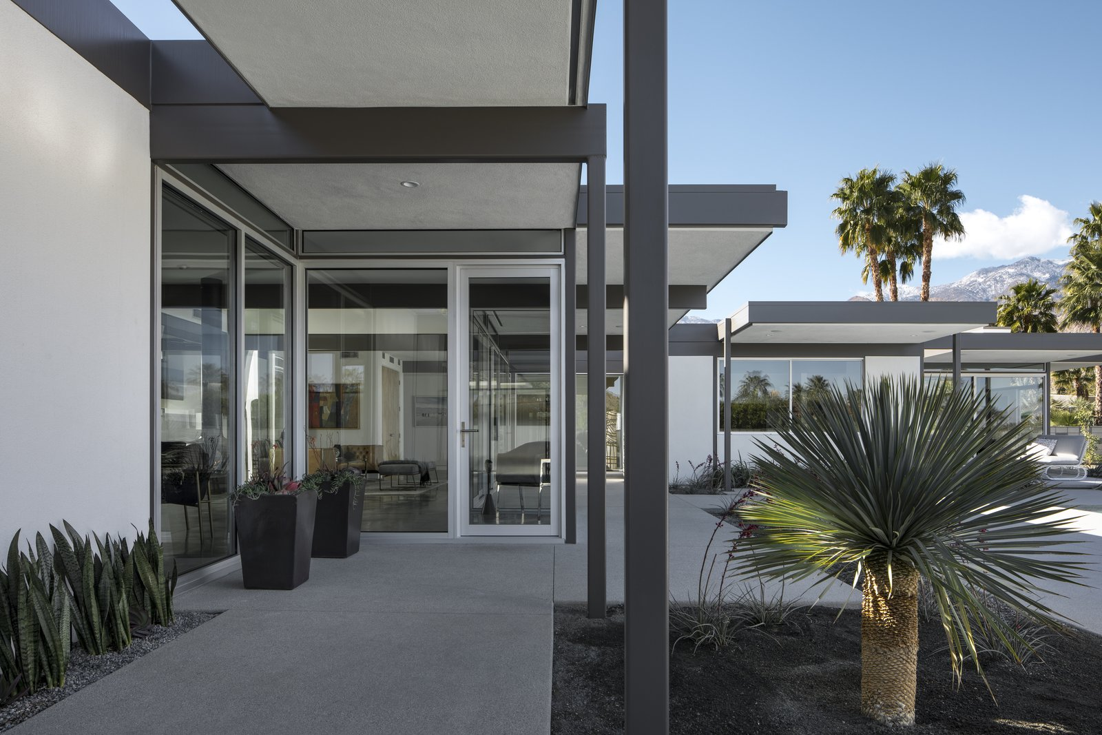 The steel post and beam structural components frame entry ways and circulation.