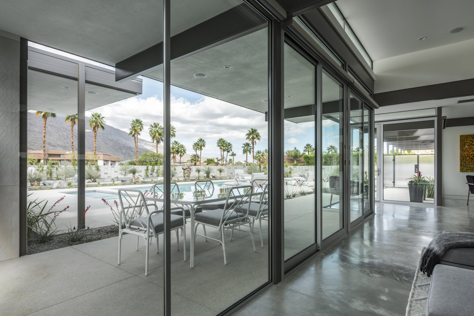 Living spaces are provided not only on the interior, but the exterior as wall.  Large overhangs provide some protection while in the outdoor elements.