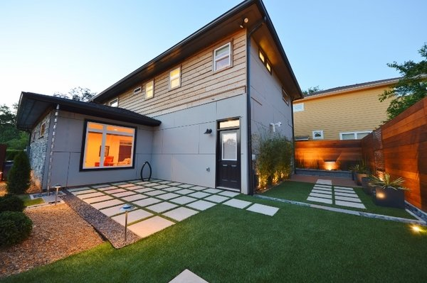 Modern home with outdoor, back yard, hardscapes, grass, small patio, porch, deck, wood fence, landscape lighting, and wood patio, porch, deck. Fish eye  Photo  of White House