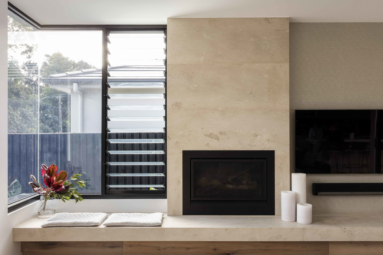Tagged: Living Room, Wood Burning Fireplace, Bench, and Storage.  The Rose Bay House by Prebuilt