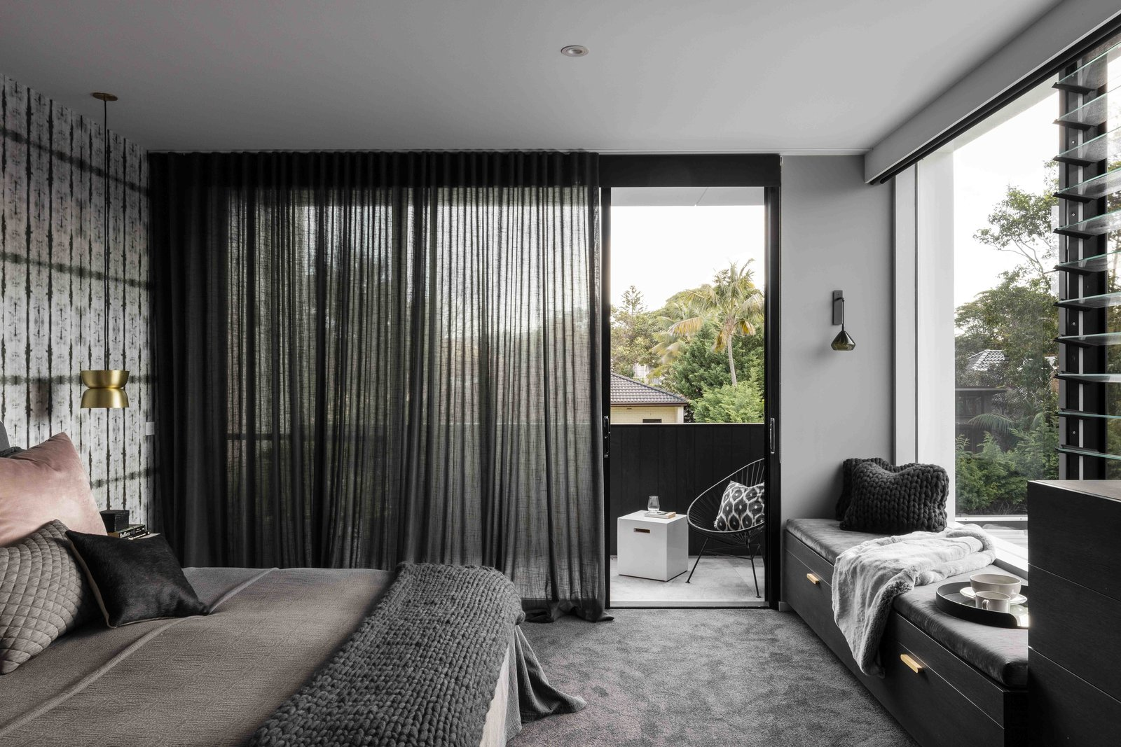 Tagged: Bedroom, Bed, Pendant Lighting, Bench, Storage, Chair, and Carpet Floor.  The Rose Bay House by Prebuilt