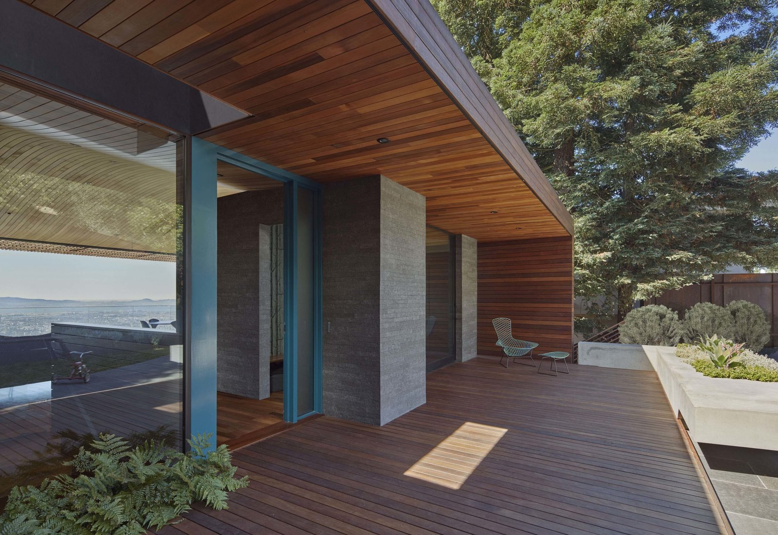 Entry porch Tagged: Outdoor, Front Yard, Grass, Shrubs, Hardscapes, Small Patio, Porch, Deck, Wood Patio, Porch, Deck, Metal Fences, Wall, and Landscape Lighting.  Skyline House by Terry & Terry Architecture