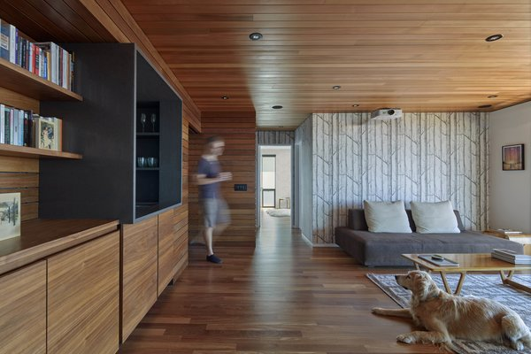 Modern home with office, home theater, storage, bookcase, shelves, and medium hardwood floor. Projection room Photo 8 of Skyline House