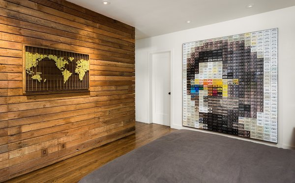 Modern home with bedroom, bed, night stands, recessed lighting, and medium hardwood floor. Bedroom walls wood reclaimed wood and art by Chris McCullough Photo 16 of Boise Residence