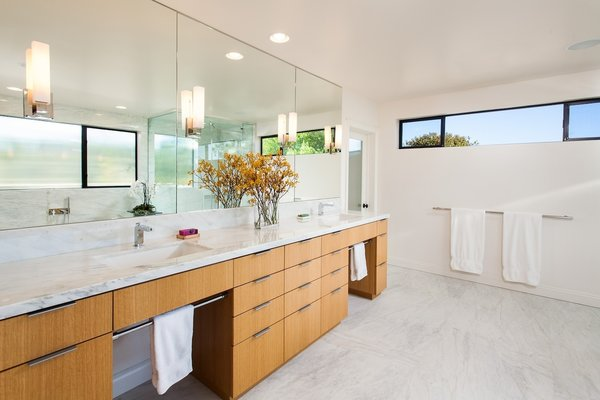 Modern home with marble counter, undermount sink, corner shower, undermount tub, open shower, wall lighting, stone slab wall, marble wall, two piece toilet, windows, metal, and casement window type. Bathroom vanity Photo 3 of Bowling Green Residence
