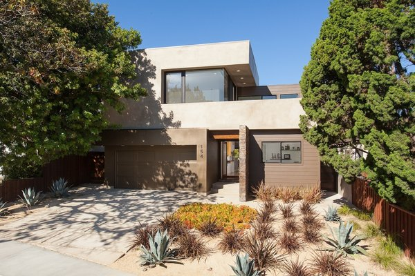 Modern home with trees, shrubs, hardscapes, grass, front yard, decomposed granite patio, porch, deck, walkways, gardens, concrete patio, porch, deck, doors, vertical fence, swing door type, exterior, and metal. Front yard Photo 11 of Bowling Green Residence