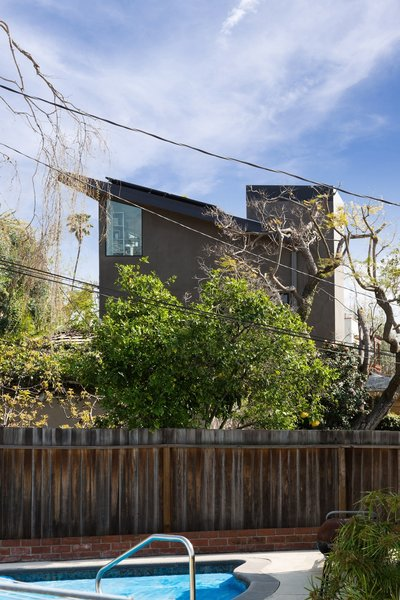 Modern home with outdoor, back yard, trees, vertical fence, side yard, and small pool. View towards the art studio from a neighbor's property Photo 10 of Mar Vista Art Studio