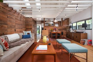 Reclaimed wood is so hot right now. There is absolutely no limit to the ways in which you can apply this sort of technique, such as the living room of Ashland Residence in Santa Monica, looking south towards the kitchen and rear yard, with open ceiling framing.