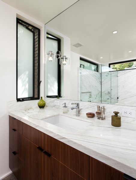 Modern home with marble counter, undermount sink, undermount tub, recessed lighting, marble wall, metal, casement window type, and bath room. Bathroom vanity with American Black Walnut cabinets Photo 10 of Ashland Residence
