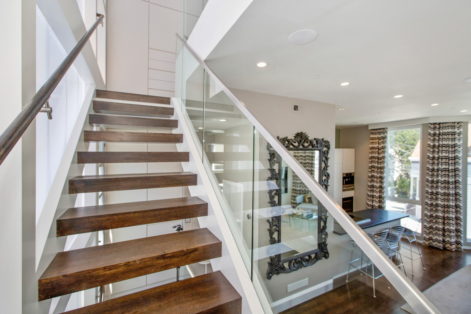 Tagged: Staircase, Wood Tread, and Glass Railing. LEED Platinum House in SF by DNM Architecture