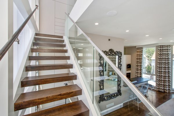 Modern home with staircase, wood tread, and glass railing. Photo 2 of LEED Platinum House in SF