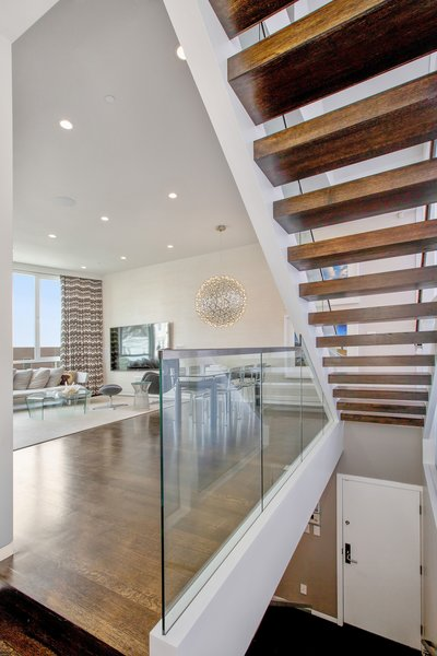 Modern home with staircase, wood tread, and glass railing. Photo 9 of LEED Platinum House in SF