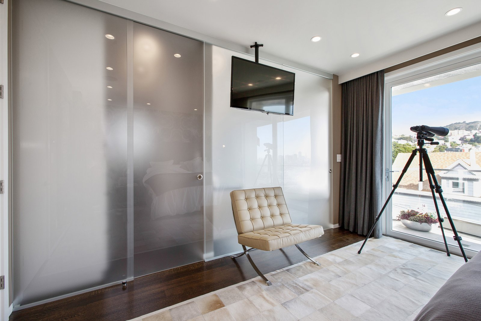 Tagged: Bedroom, Ceiling Lighting, and Medium Hardwood Floor.  LEED Platinum House in SF by DNM Architecture