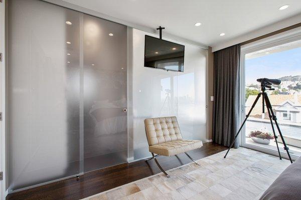 Modern home with bedroom, ceiling lighting, and medium hardwood floor. Photo 3 of LEED Platinum House in SF