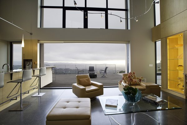 Modern home with living room, track lighting, accent lighting, ottomans, chair, concrete floor, and coffee tables. Photo 8 of Sonoma SIPS House