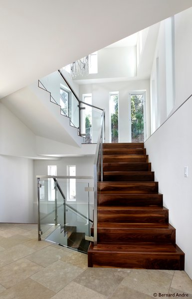Modern home with staircase, wood tread, and glass railing. Photo 9 of Hillsborough Hillside Home