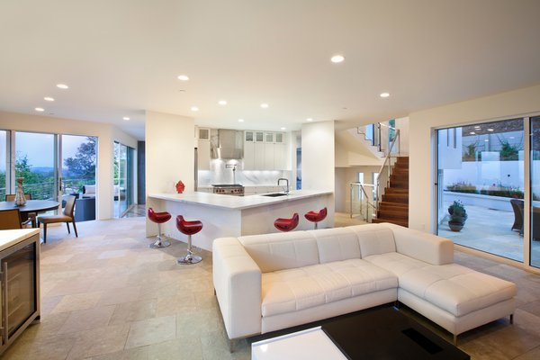 Modern home with living room, porcelain tile floor, sectional, recessed lighting, and sofa. Photo 6 of Hillsborough Hillside Home
