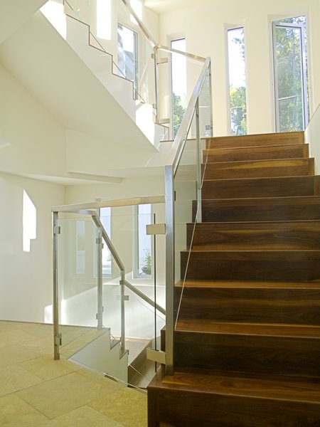Modern home with staircase, wood tread, and glass railing. Photo 3 of Hillsborough Hillside Home