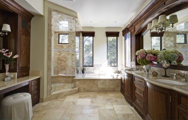 Modern home with bath room, stone counter, travertine floor, undermount sink, soaking tub, recessed lighting, enclosed shower, accent lighting, stone tile wall, mosaic tile wall, wall lighting, and one piece toilet. Master Bath remodel Photo 10 of Rustic elegance