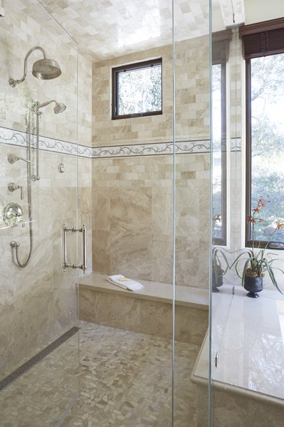 Modern home with bath room, stone counter, travertine floor, soaking tub, stone tile wall, enclosed shower, and recessed lighting. Steam Shower Photo 12 of Rustic elegance