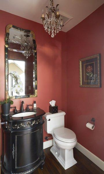 Modern home with bath room, granite counter, medium hardwood floor, pendant lighting, recessed lighting, undermount sink, and two piece toilet. Powder Room  Photo 15 of Rustic elegance