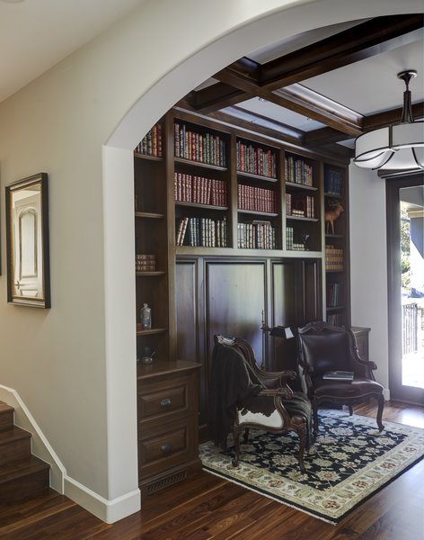 Modern home with office, library, bookcase, storage, chair, shelves, lamps, and medium hardwood floor. Library Photo 17 of Rustic elegance
