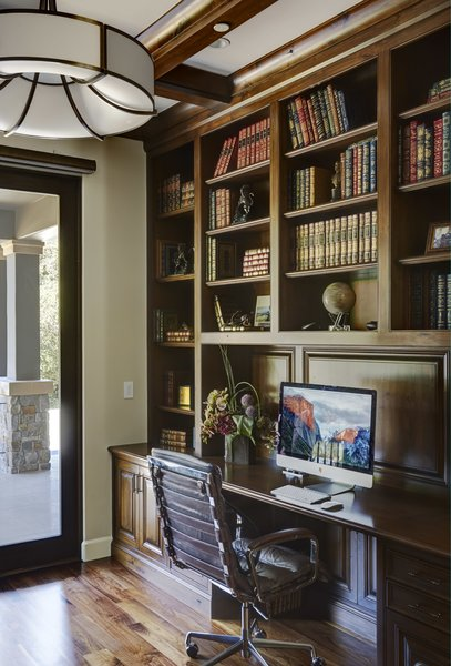 Modern home with office, library, chair, storage, desk, bookcase, shelves, lamps, and medium hardwood floor. Library Photo 18 of Rustic elegance